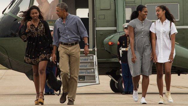 Barack Obama mit Tochter Sasha, Ehefrau Michelle und Tochter Malia (Bild: AFP)