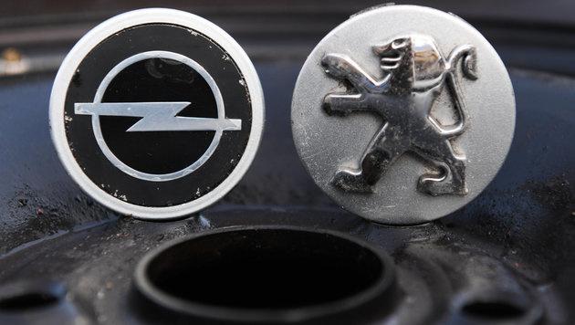 Opel-Übernahme durch Peugeot/Citroen abgeschlossen (Bild: APA/dpa/Arne Dedert)