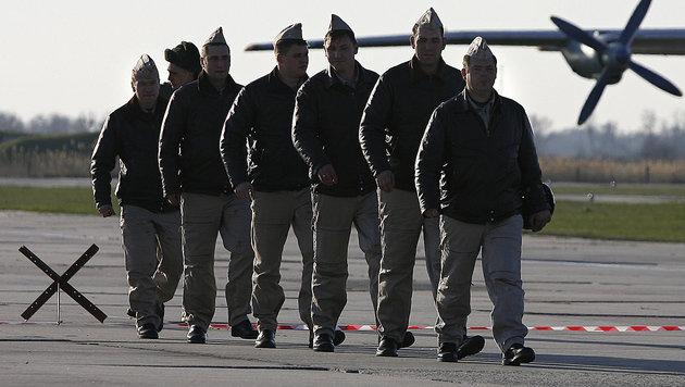 Russische Soldaten auf der Basis Hmeimim (Bild: AFP)