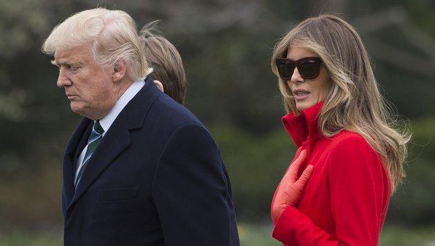 Donald und Melania Trump auf dem Weg in ihr Wochenenddomizil in Florida (Bild: AFP)
