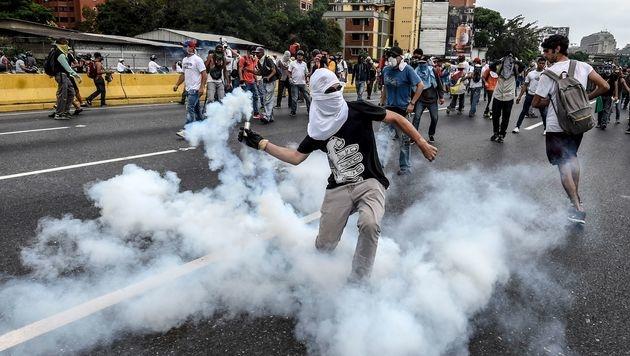 Caracas: Zwölf Tote nach Unruhen und Plünderungen (Bild: AFP)