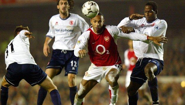 Ugo Ehiogu (re.) im Duell mit Thierry Henry (Bild: AFP)