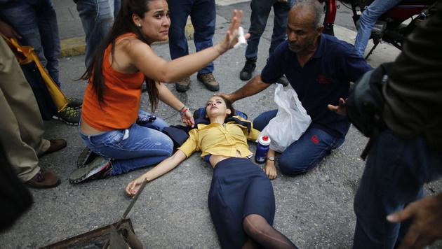Caracas: Zwölf Tote nach Unruhen und Plünderungen (Bild: AP)
