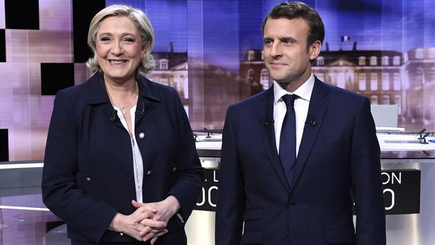 Le Pen und Macron trafen einander beim einzigen TV-Duell im Wahlkampf. (Bild: AFP)