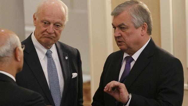 Die Delegationsleiter Russlands, der Türkei und des Iran in Kasachstan (Bild: AFP)