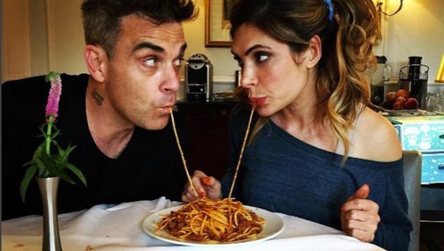 Fast so schön wie bei Susi und Strolch: Robbie Williams und seine Ayda beim Spaghetti-Schlürfen (Bild: Viennareport)