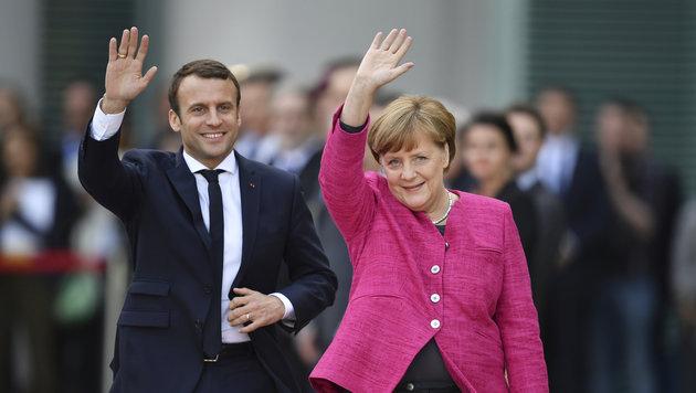Macron und Merkel (Bild: AP)
