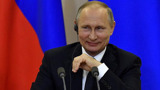 """Kremlchef Putin findet die """"politische Schizophrenie"""" in den USA ziemlich amüsant. (Bild: AP)"""