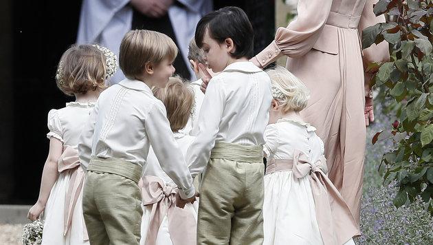 Süß: die Blumenmädchen und sogenannten Pageboys (Bild: AP)