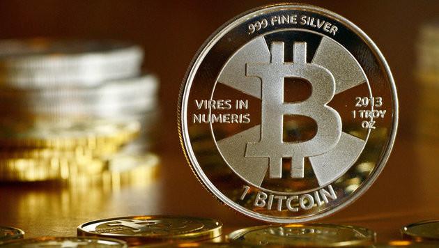Bitcoin: Wenige zahlen damit, viele haben Bedenken (Bild: APA/dpa-Zentralbild/Jens Kalaene)
