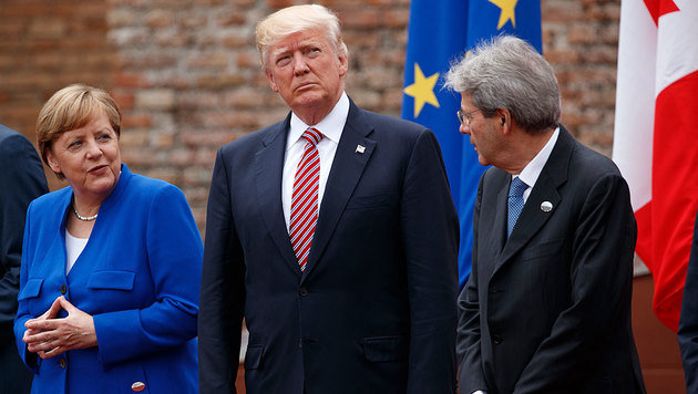 Viele Freunde hat Trump (hier neben Merkel und Gentiloni) beim G7-Gipfel nicht gewonnen. (Bild: AP)