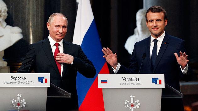 Wladimir Putin und Emmanuel Macron (Bild: AFP/Geoffroy van der Hasselt)