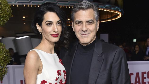 Amal und George Clooney (Bild: AP)