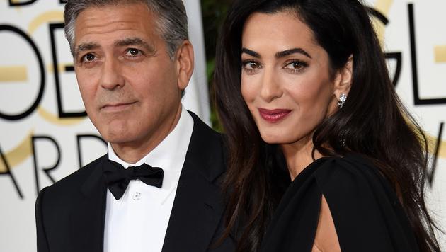 George Clooney und seine Amal (Bild: AFP)