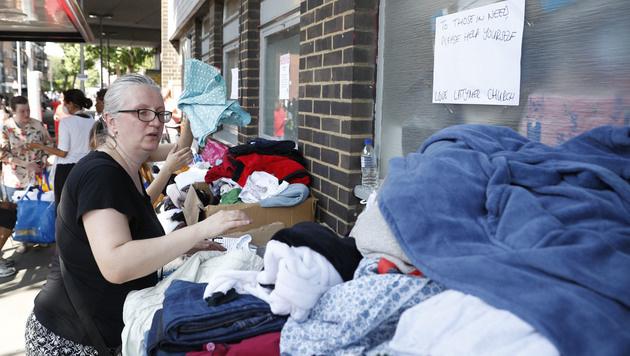 Augenzeuge fing aus Fenster geworfenes Baby auf (Bild: AFP)