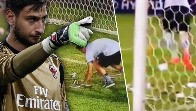Milan-Torhüter Donnarumma mit Spielgeld beworfen (Bild: AFP, YouTube.com)