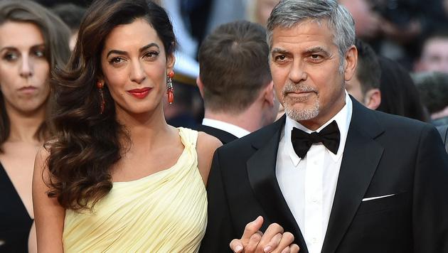 George Clooney mit seiner Amal (Bild: AFP)
