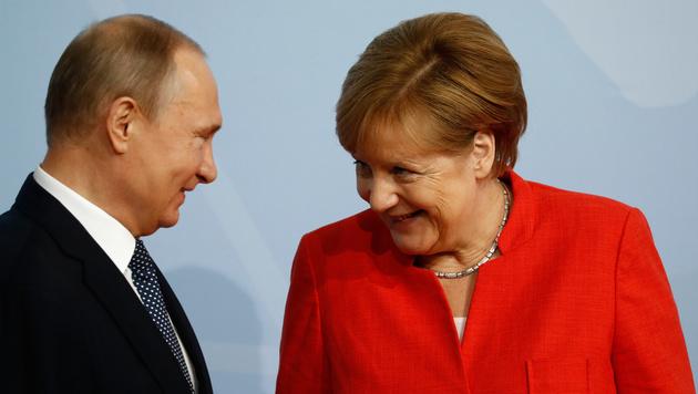 Merkel mit Putin (Bild: AFP)