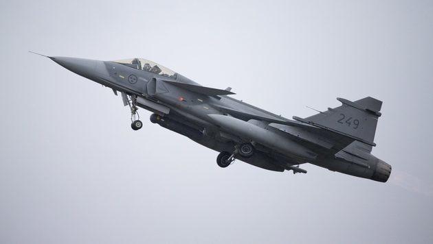 Ein Gripen während einer Luftkampfübung über Schweden (Bild: AFP)