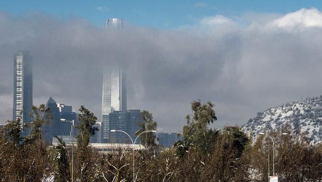 Schneesturm legt Chiles Hauptstadt Santiago lahm (Bild: AFP/Martin Bernetti)