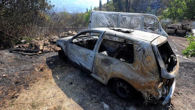 Ausgebrannte Autos nahe der Stadt Split (Bild: AFP)