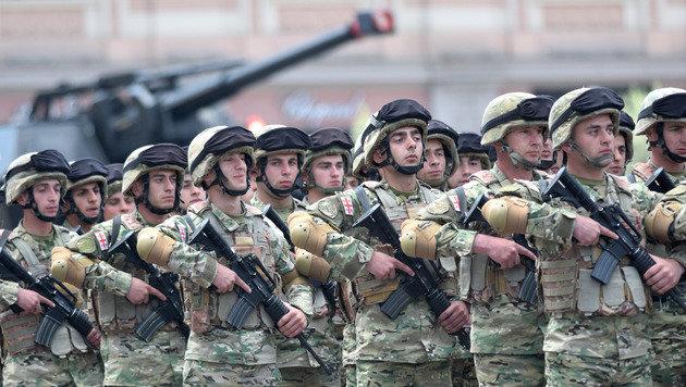 Georgische Soldaten trainieren nun zwei Wochen lang mit Kameraden aus den USA. (Bild: AFP)