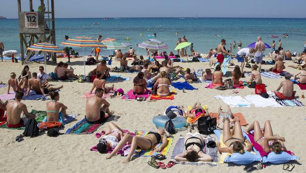 Touristen in Palma de Mallorca (Bild: AFP)