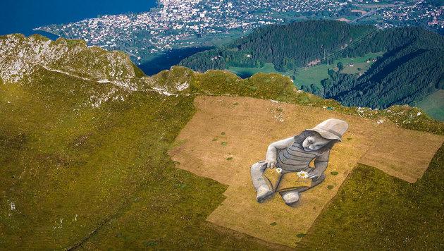 Künstler malt Riesenbild auf Schweizer Berghang (Bild: EPA/Valentin Flauraud)