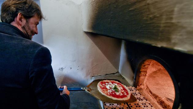 Pizza backen ist jetzt UNESCO-Weltkulturerbe (Bild: AP)
