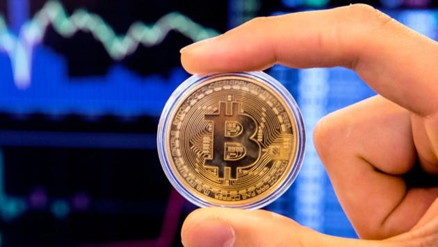 Der Kurs des Bitcoin erwies sich in der Vergangenheit als höchst schwankungsanfällig. (Bild: AFP)