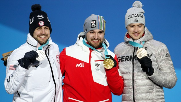 Chris Mazdzer (USA), David Gleirscher (AUT) und Johannes Ludwig (GER).