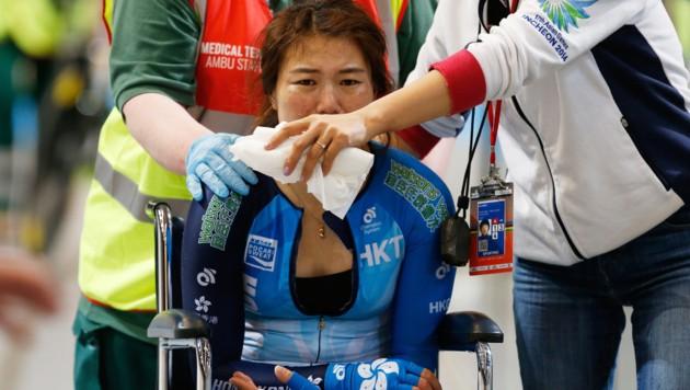 Xiaojuan Diao weint