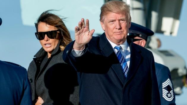 Donald Trump mit seiner Ehefrau Melania (Bild: AP)