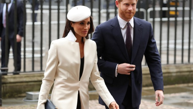 Meghan Markle mit Prinz Harry (Bild: AFP or licensors)