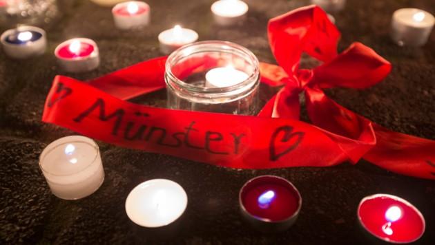 Trauer um die Toten von Münster (Bild: AP)