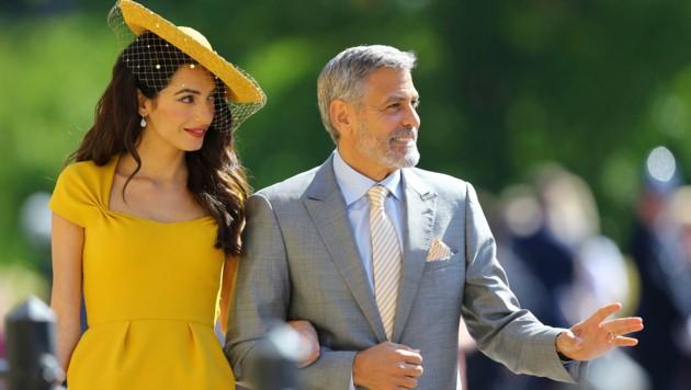 Amal Clooney und George Clooney (Bild: PA)