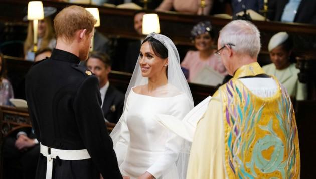 Prinz Harry und Meghan Markle beim Jawort (Bild: AFP and licensors)