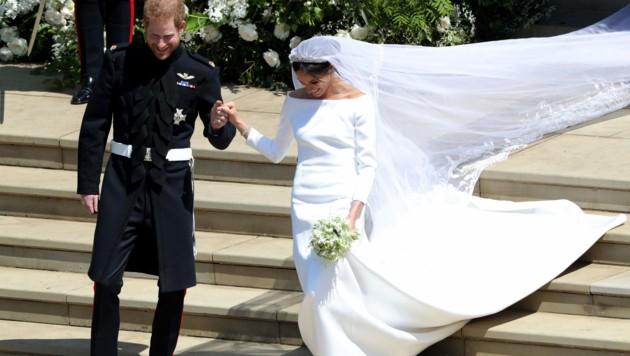 Das royale Brautpaar beim Verlassen der Kirche (Bild: AFP and licensors)