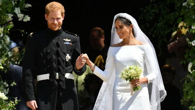 Harry und Meghan beim Verlassen der Kirche (Bild: AFP)