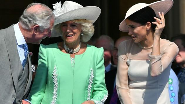 Prinz Charles mit Herzogin Camilla und Herzogin Meghan (Bild: AFP or licensors)