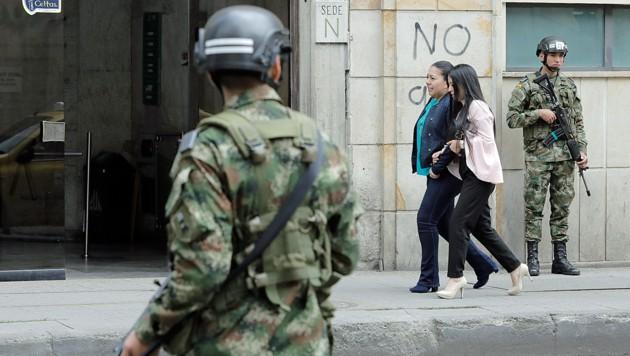 Das Drohnen-Verbot und die erhöhte Präsenz von Soldaten und Polizisten sollen dafür sorgen, dass die Amtseinführung ohne Zwischenfälle über die Bühne geht. (Bild: APA/AFP/JOHN Vizcaino)