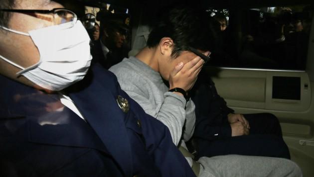 Takahiro Shiraishi bei seiner Verhaftung vor drei Jahren (Bild: AFP)