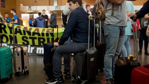 Passagiere waren auf ihren Flug nach Malaga. (Bild: The Associated Press.)