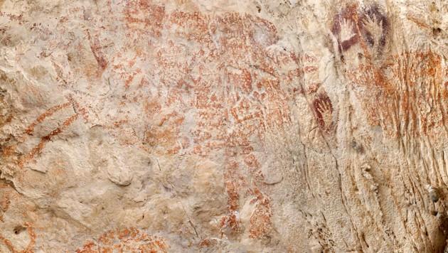 Die 40.000 Jahre alte Darstellung eines nicht genau erkennbaren Tieres (Bild: Luc-Henri Fage/kalimanthrope.com via AP)