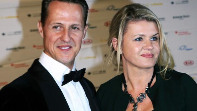 Michael Schumacher und seine Ehefrau Corinna ... (Bild: APA/dpa/Fredrik von Erichsen)