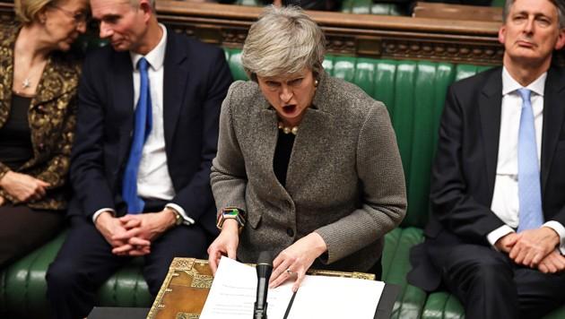 Im britischen Parlament hält sich die Unterstützung für die Premierministerin und ihren Brexit-Kurs schwer in Grenzen. (Bild: AFP)