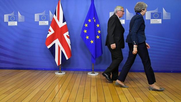 Turbulente Zeiten für EU-Kommissionspräsident Jean-Claude Juncker und die britische Regierungschefin Theresa May (Bild: AFP )