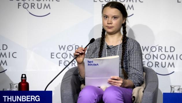 Greta Thunberg (16) bei einer Podiumsdiskussion in Davos (Bild: APA/KEYSTONE/GIAN EHRENZELLER)