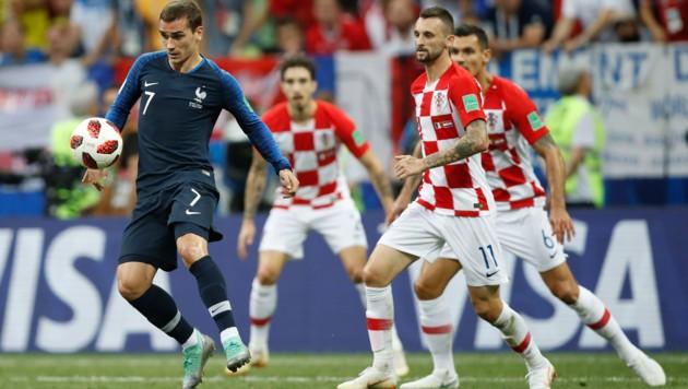 Antoine Griezmann (am Ball) jubelte im Vorjahr mit Frankreich über den WM-Titel. (Bild: AP/Francisco Seco)