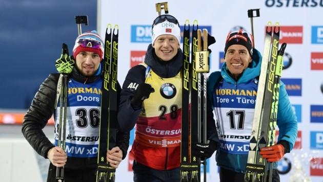 Alexander Loginow (RUS), Johannes Thingnes Bö (NOR) und Quentin Fillion Maillet (FRA) (Bild: AFP)
